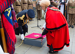 The Mayor of Haringey Cllr Gina Adamou unveils the paving stone together with Lieutenant General Tyrone Urch as local residents, family members and representatives of the Armed Forces honour Lieutenant-Colonel Sir Brett Mackay Cloutman VC MC KC with the unveiling of the final London Victoria Cross Commemorative paving stone in Hornsey, London. November 06 2018.