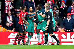 Tottenham Hotspur's Moussa Sissoko (third right) and Southampton's Nathan Redmond come to blows during the Premier League match at St Mary's Stadium, Southampton.