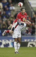 Photo: Aidan Ellis.<br /> Bolton Wanderers v Blackburn Rovers. The Barclays Premiership. 04/03/2007.<br /> Blackburn's Brett Emerton jumps on Bolton's Nicolas Anelka trying to win the header