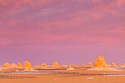 Sunset above the the chalk rock formations of the Sahara Beida (White Desert) near Farafra, Egypt