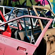 Damaged car doors at garage