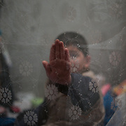 A child in a temporary room of a bomb shelter outside Donetsk.