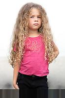 caucasian little girl portrait brat attitude isolated studio on white background