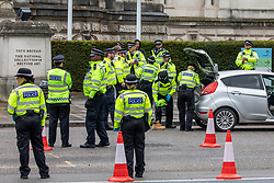 © Licensed to London News Pictures. 29/04/2020. London, UK. Officers search a car next to Tate Britain in Westminster. A large Police presence in Westminster today as constables stopped motorists on Millbank next to Tate Britain to check drivers and searching vehicles during lockdown as the coronavirus pandemic crisis continues. Photo credit: Alex Lentati/LNP