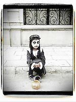 A young child dressed in costume for Dia De Los Muertos in downtown Oaxaca, Mexico 2012