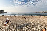 Bondi Beach in early morning light. A guy leaves  carrying his Surf Ski,Sydney, Australia.