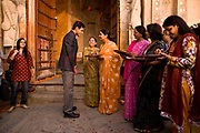 At a Hindu wedding the bride groom arrives at the venue of the ceremong with his family and friends and is greeted by the bride's family and friends, Neemrana Fort Palace, Rajasthan, India.