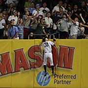 Ichiro Suzuki, New York Yankees, watches a home run from Brayan Pena, Cincinnati Reds, sail over the right field wall during the New York Yankees Vs Cincinnati Reds baseball game at Yankee Stadium, The Bronx, New York. 18th July 2014. Photo Tim Clayton