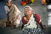 Amaravathi breathes deeply at the daily exercise class at the Tamaraikulum Elders village, Tamil Nadu, India