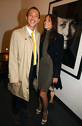 DAN MACMILLAN and  ASTRID MUNOZ at a private view of an exhibition of portrait photographs by Danish photographer Marc Hom held at the Hamiltons Gallery, 13 Carlos Place, London on 23rd October 2006.<br /><br />NON EXCLUSIVE - WORLD RIGHTS