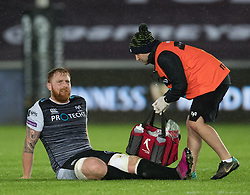 Dan Baker of Ospreys receives treatment<br /> <br /> Photographer Simon King/Replay Images<br /> <br /> Guinness PRO14 Round 6 - Ospreys v Connacht - Saturday 2nd November 2019 - Liberty Stadium - Swansea<br /> <br /> World Copyright © Replay Images . All rights reserved. info@replayimages.co.uk - http://replayimages.co.uk