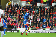 Christian Fuchs of Leicester City (l) and Mame Biram Diouf of Stoke City jump for the ball. Premier league match, Stoke City v Leicester City at the Bet365 Stadium in Stoke on Trent, Staffs on Saturday 4th November 2017.<br /> pic by Chris Stading, Andrew Orchard sports photography.