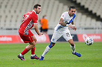 ATHENS, GREECE - OCTOBER 11: Dimitris Kourbelisof Greece and Artur Ioniţaof Moldova during the UEFA Nations League group stage match between Greece and Moldova at OACA Spyros Louis on October 11, 2020 in Athens, Greece. (Photo by MB Media)
