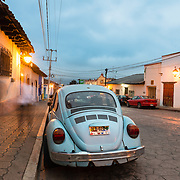 Old car in front of Spanish colonial building in San Christobal, Mexico