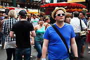 Man in white sunglasses and a blue t-shirt and hat. Borough Market is a thriving Farmers market near London Bridge. Saturday is the busiest day.