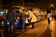 Two migrant women with two little girls enter a car of a stranger who allegedly will help them cross the Spanish-French border. Irun (Basque Country). March 14, 2019. A group of volunteers has created a host network to serve migrants and inform about the public services they are entitled to and the ways to cross the border. This group of volunteers is avoiding a serious humanitarian problem Irun, the Basque municipality on the border with Hendaye. As the number of migrants arriving on the coasts of southern Spain incresead, more and more migrants are heading north to the border city of Irun. French authorities have reacted by conducting random checks as far as the city of Bordeaux, more than 200 kilometers north of the border. Migrants who are caught are then deported back to Irun. (Gari Garaialde / Bostok Photo).
