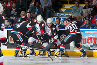 KELOWNA, CANADA - SEPTEMBER 28: Brad Morrison #9 and Brogan O'Brien #15 of Prince George Cougars are checked by Connor Bruggen-Cate #20 and Jake Kryski #14 of Kelowna Rockets on September 28, 2016 at Prospera Place in Kelowna, British Columbia, Canada.  (Photo by Marissa Baecker/Shoot the Breeze)  *** Local Caption *** Jake Kryski; Connor Bruggen-Cate; Brogan O'Brien; Brad Morrison;