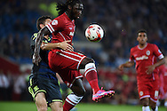 Kenwyne Jones of Cardiff city ® controls the ball watched closely by Damia Abella of Middlesbrough (l). Skybet football league championship match, Cardiff city v Middlesbrough at the Cardiff city stadium in Cardiff, South Wales on Tuesday 16th Sept 2014<br /> pic by Andrew Orchard, Andrew Orchard sports photography.