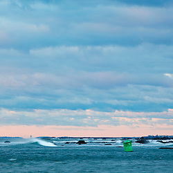 A cloudy sunrise over the entrance to Rye Harbor in Rye, New Hampshire.