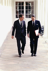 Washington, D.C. - May 3, 1988 -- United States President Ronald Reagan and Vice President George H.W. Bush walk on the Colonnade at the White House in Washington, DC on May 3, 1988. Photo by White House/CNP/ABACAPRESS.COM