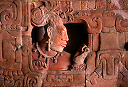 GUATEMALA, MAYAN CULTURE altar with faces from Piedras Negras