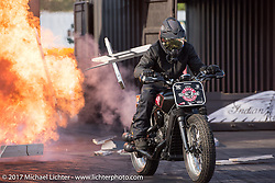Crashing through a wall of fire on an Indian Scout at the Indian footprint during the annual Sturgis Black Hills Motorcycle Rally. Sturgis, SD. USA. Saturday August 12, 2017. Photography ©2017 Michael Lichter.