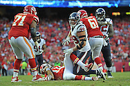 KANSAS CITY, MO - OCTOBER 20:  Defensive end J.J. Watt #99 of the Houston Texans reacts after sacking quarterback Alex Smith #11 of the Kansas City Chiefs during the second half on October 20, 2013 at Arrowhead Stadium in Kansas City, Missouri.  Kansas City won 17-16. (Photo by Peter Aiken/Getty Images) *** Local Caption *** J.J. Watt;Alex Smith