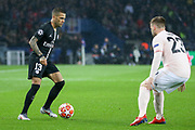 Dani Alves of Paris Saint-Germain takes on Manchester United Defender Luke Shaw during the Champions League Round of 16 2nd leg match between Paris Saint-Germain and Manchester United at Parc des Princes, Paris, France on 6 March 2019.