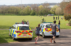 © Licensed to London News Pictures; 05/04/2020; Bristol, UK. Coronavirus Pandemic 2020; Police patrol in Greville Smyth Park on a Sunday afternoon in warm weather, during the UK wide coronavirus lockdown with the biggest restrictions on freedom of movement ever imposed in the UK. People are told to stay at home except for essential work that cannot be done at home, shopping for food, medical appointments and taking exercise once a day all while maintaining social distance. Photo credit: Simon Chapman/LNP.