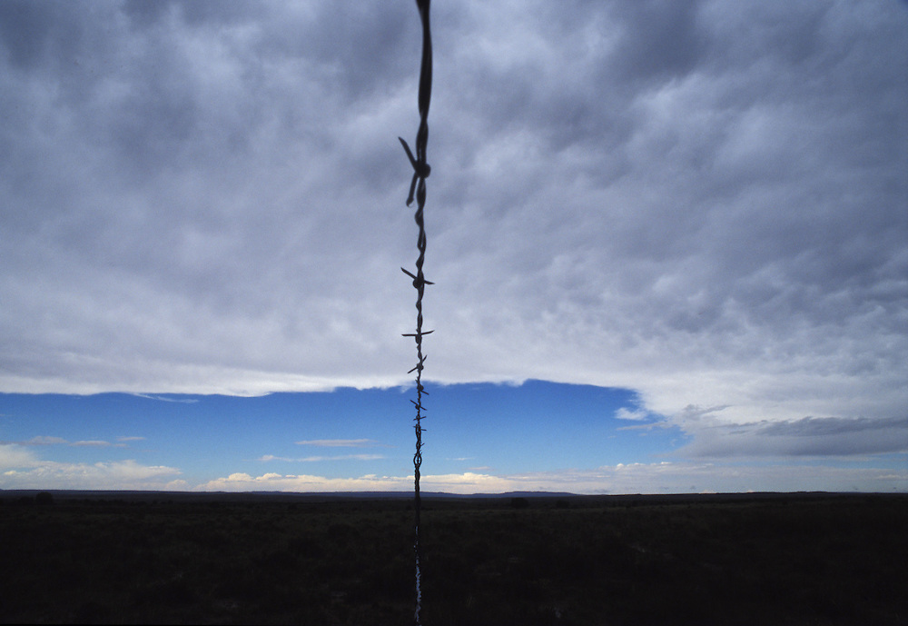 """Dividing the Sky - The Navajo-Hopi land dispute, a long, deeply emotional conflict in remote northeastern Arizona, haunts both tribes.  """"how many time must we be fenced in?"""" Navajo resistor Ida Mae Clinton asks."""