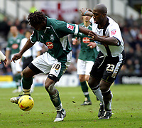 Photo: Dave Linney.<br />Derby County v Plymouth Argyle. Coca Cola Championship. 25/02/2006.Derby's Darren Moore(R) keeps a close eye on   Vincent  Pericard