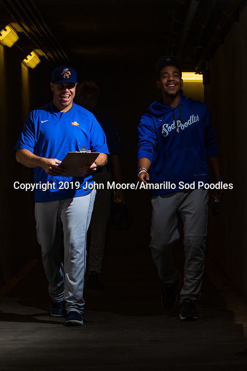 Amarillo Sod Poodles hitting coach Raul Padron and Amarillo Sod Poodles pitcher Luis Patino (35) before the game against the Tulsa Drillers during the Texas League Championship on Saturday, Sept. 14, 2019, at OneOK Field in Tulsa, Oklahoma. [Photo by John Moore/Amarillo Sod Poodles]