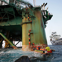 Greenpeace activists take non violent direct action on an oil exploratory rig , the Leiv Eiriksson , in Baffin Bay off the coast of Greenland in protest at what the environmental pressure group views as taking unneccesary risks in a vulnerable environement.