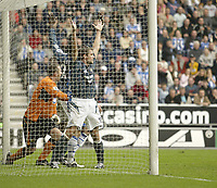 Photo: Aidan Ellis.<br /> Wigan Athletic v Newcastle United. The Barclays Premiership. 15/10/2005.<br /> Newcastle's Michael Owen claims Alan Shearer header crossed the line