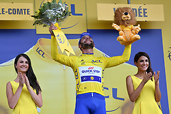 July 7, 2018 - Fontenay-Le-Comte, FRANCE - Colombian Fernando Gaviria of Quick-Step Floors celebrates on the podium in the yellow jersey of leader in the overall ranking after winning the first stage of the 105th edition of the Tour de France cycling race, 201km from Noirmoutier-en-l'Ile to Fontenay-le-Comte, France, Saturday 07 July 2018. This year's Tour de France takes place from July 7th to July 29th. BELGA PHOTO DAVID STOCKMAN (Credit Image: © David Stockman/Belga via ZUMA Press)