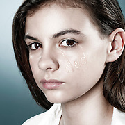 An advertising campaign conceptual photographic image, illustrating a girls taels for her father.
