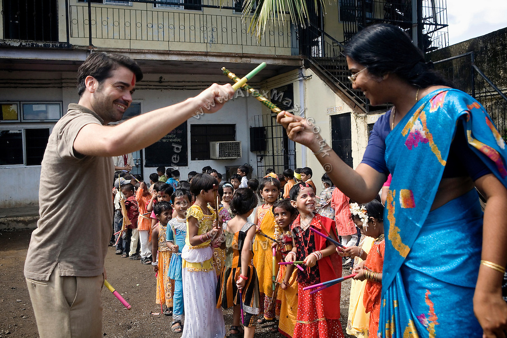 Jaume Sanllorente, the director general of Sonrisas de Bombay is celebrating the Hindu festival of Durga Puja with a teacher and some young student in the courtyard of a school run by the fast-growing Spanish NGO in Mumbai, India.
