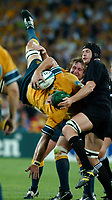 Photo: Steve Holland.<br />New Zealand v Australia. Semi-Final, at the Telstra Stadium, Sydney. RWC 2003. 15/11/2003. <br />David Giffin comes down upside down for the second time in the competition.