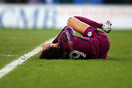 Leroy Sane of Manchester City lies injured after a reckless tackle from Joe Bennett of Cardiff city for which he gets a booking off referee Lee Mason, many people believed it should have been a straight red card. The Emirates FA Cup, 4th round match, Cardiff city v Manchester City at the Cardiff City Stadium in Cardiff, South Wales on Saturday 28th January 2018.<br /> pic by Andrew Orchard, Andrew Orchard sports photography.