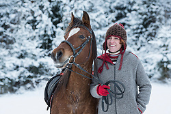 Mature woman with horse during winter, Bavaria, Germany