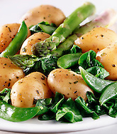 Medley of aspargus spears, potatoes mange tout vegetables food photos