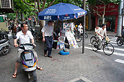 Street scene with moped traffic in Shanghai, China.