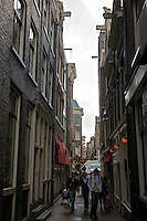 Tourists in the narrow streets of the red light district in Amsterdam.
