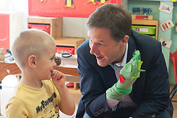 LNP HIGHLIGHTS OF THE WEEK 25/04/14 © Licensed to London News Pictures. 24/04/2014. Colchester, UK. 4 year old Dom Bearman laughs after Nick Clegg plays with a hand puppet they made together.  Deputy Prime Minister Nick Clegg visits Hazelmere Infant School and Nannas Day Nursery in Colchester on Thursday 24 April, to talk to teachers and parents about free childcare for two-year-olds, free school meals and the pupil premium.. Photo credit : Stephen Simpson/LNP