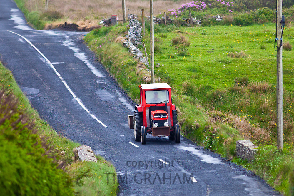 Small farm tractor in the lanes in County Clare, West of Ireland