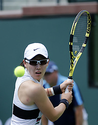March 7, 2019 - Los Angeles, California, U.S - Saisai Zheng of China, returns the ball to Kristina Mladenovic of France, during the women singles first round match of the BNP Paribas Open tennis tournament on Thursday, March 7, 2019 in Indian Wells, California. Mladenovic won 2-0. (Credit Image: © Ringo Chiu/ZUMA Wire)