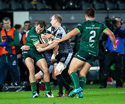John Porch of Connacht under pressure from Luke Price of Ospreys<br /> <br /> Photographer Simon King/Replay Images<br /> <br /> Guinness PRO14 Round 6 - Ospreys v Connacht - Saturday 2nd November 2019 - Liberty Stadium - Swansea<br /> <br /> World Copyright © Replay Images . All rights reserved. info@replayimages.co.uk - http://replayimages.co.uk