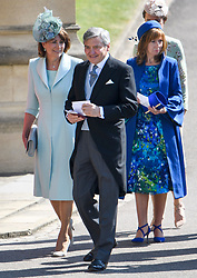 © Licensed to London News Pictures. 19/05/2018. London, UK. CAROE AND MICHAEL MIDDLETON, parents of Duchess of Cambridge. Guests arrive at The wedding of Prince Harry, The Duke of Sussex to Meghan Markle, The Duchess of Sussex, at St George's Chapel in Windsor. Photo credit: Ben Cawthra/LNP