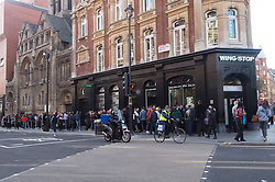© Licensed to London News Pictures. 31/10/2018. London, UK.  Customers queue up outside at the opening Wingstop chicken restaurant in Cambridge Circus. Photo credit: Ray Tang/LNP