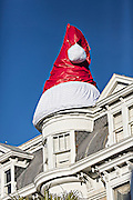 A giant Santa Claus hat sits on the roof of a historic home in Charleston, South Carolina.